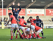 Saracens scrum-half Richard Wigglesworth clears from a ruck under pressure from Sale Sharks second-row Andrei Ostrikov during the Aviva Premiership match Sale Sharks -V- Saracens at The AJ Bell Stadium, Salford, Greater Manchester, England on November  20  2016. (Steve Flynn/IOS via AP)
