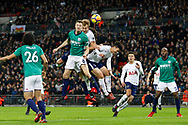 Tottenham Hotspur forward Harry Kane (10) wins a header during the Premier League match between Tottenham Hotspur and West Bromwich Albion at Wembley Stadium, London, England on 25 November 2017. Photo by Andy Walter.