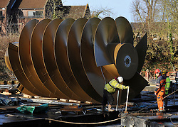 © Licensed to London News Pictures. 20/12/2011, Windsor, UK. The screw is floated on a barge before lifting. One of the two giant 40 tonne Archimedes screws is lifted into place at Romney Weir on the River Thames. The screws, the largest in the UK and fish friendly, will generate 300 kilowatts of energy every hour to power Windsor Castle. It is the largest hydropower scheme in the South East of England. Photo credit: Stephen Simpson/LNP