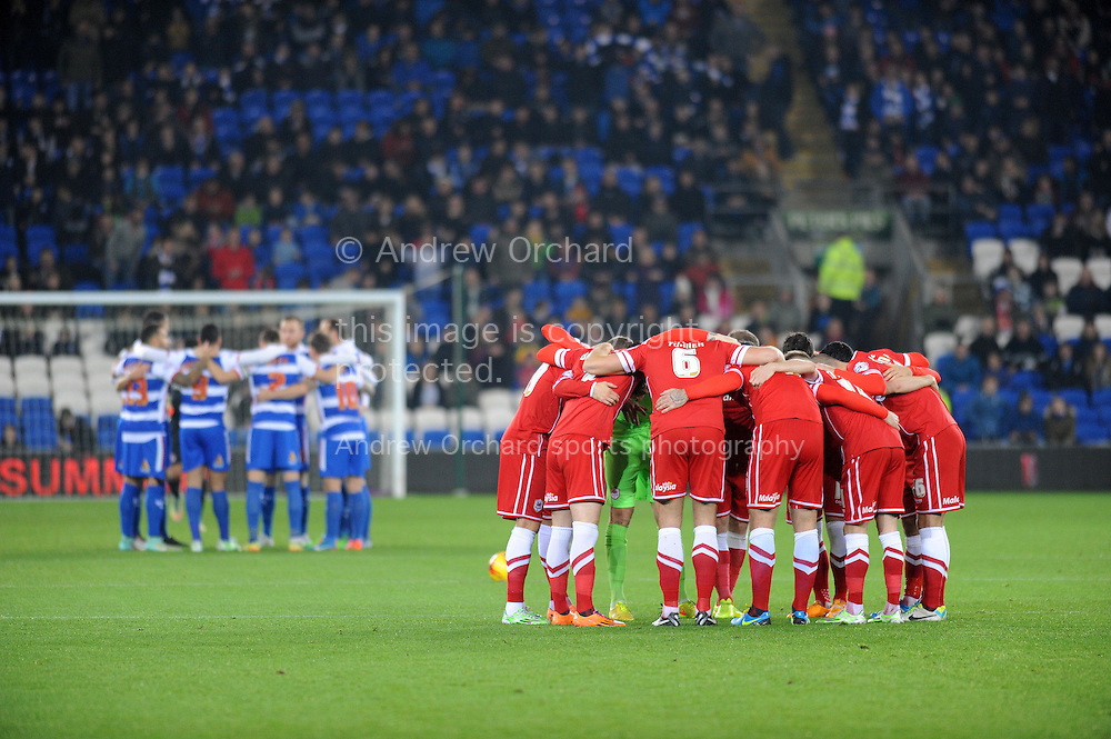 Cardiff City players group huddle ahead of kick off.<br /> Skybet football league championship match, Cardiff city v Reading at the Cardiff city stadium in Cardiff, South Wales on Friday 21st November 2014<br /> pic by Phil Rees, Andrew Orchard sports photography.
