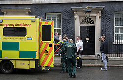 © Licensed to London News Pictures. 15/05/2017. London, UK. An injured worker is lifted into an ambulance outside 10 Downing Street after he was injured inside. A COBRA meeting is being held later as members of British government are meeting to discuss the recent cyber attack on over 150 countries, which crippled parts of the NHS.  Photo credit: Peter Macdiarmid/LNP