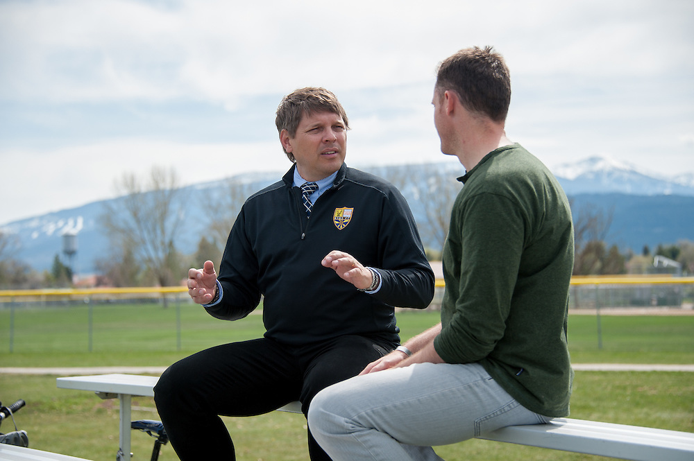 Diren Dede's soccer coach, Jay Bostrom (left), and his history teacher Cameron Johnson (right) of Big Sky High School in Missoula, Montana, talking about the weeks events at the soccer field where Dede, a 17-year-old German exchange student who was shot and killed by a neighbor, played.
