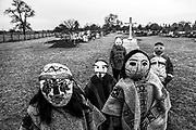 """Carimallin Community, Maihue, Region of the Rivers, Chile Children in the Mapuche cemetery of Maihe. Very close to it is intended to install the hydroelectric plant where the communities in the area oppose the project. The masks are used in the """"guillatunes"""", spiritual ceremonies carried out by the spiritual authorities once a year."""
