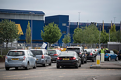 © Licensed to London News Pictures. 25/04/2020. London, UK. Traffic queueing to enter a temporary COVID-19 testing facility  at IKEA in Wembley, north London. The public have been told they can only leave their homes when absolutely essential, in an attempt to fight the spread of coronavirus COVID-19 disease. Photo credit: Ben Cawthra/LNP
