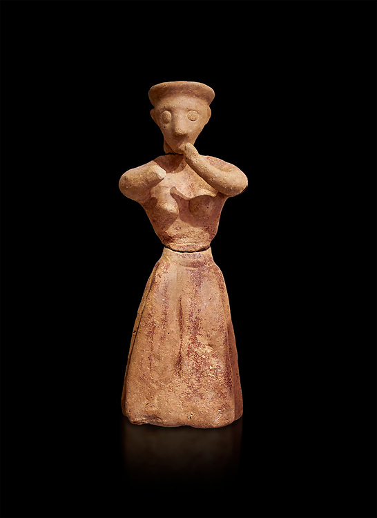 Minoan clay female figurine in the attitude of worship, Chamezi 1900-1700 BC; Heraklion Archaeological  Museum, black background. .<br /> <br /> If you prefer to buy from our ALAMY PHOTO LIBRARY  Collection visit : https://www.alamy.com/portfolio/paul-williams-funkystock/minoan-art-artefacts.html . Type -   Heraklion   - into the LOWER SEARCH WITHIN GALLERY box. Refine search by adding background colour, place, museum etc<br /> <br /> Visit our MINOAN ART PHOTO COLLECTIONS for more photos to download  as wall art prints https://funkystock.photoshelter.com/gallery-collection/Ancient-Minoans-Art-Artefacts-Antiquities-Historic-Places-Pictures-Images-of/C0000ricT2SU_M9w