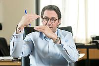 03 JUL 2019, BERLIN/GERMANY:<br /> Andreas Scheuer, CSU, Bundesminister fuer Verkehr und digitale Infrastruktur, waehrend einem Interview, in seinem Buero, Bundesministerium fuer Verkehr und digitale Infrastruktur<br /> IMAGE: 20190703-01-056