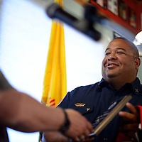 073014       Cayla Nimmo<br /> <br /> For his part in helping save the life pf Juli Gartner, Albuquerque based EMS Captain Kerry McKinstry was honored with with a plaque and the patriotic public employee shirt during a Rotary Club meeting at Sammy C's in downtown Gallup Wednesday afternoon.