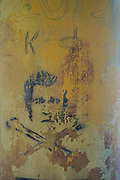 Abstract faded portrait painting on a wall
