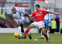 Photo: Leigh Quinnell.<br /> Nottingham Forest v Swindon Town. Coca Cola League 1. 25/02/2006. Swindons Aaron Brown gets past Notingham Forests Jack Lester.