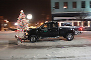 Middletown, NY - A City of Middletown Parks and Recreation department truck plows a downtown street as snow falls during a winter storm on Dec. 19, 2008.