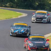 Alton, VA - Aug 26, 2016:  The RS1 SuperSeats Romero Investment Advisors Porsche Cayman races through the turns at the Oak Tree Grand Prix at Virginia International Raceway in Alton, VA.