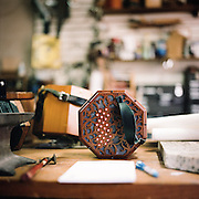 """A concertina at Homewood Musical Instrument Company, where owner Bob Tedrow has been making concertinas since the mid-1990's. """"It's an incredible work of art,"""" Tedrow said. """"There's just no other instrument that combines charming workmanship and early 19th century craftsmanship, all with the portability of a six pack of beer."""""""