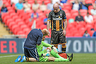 The physio checks Karl Dryden (Morpeth Town) during the FA Vase match between Hereford and Morpeth Town at Wembley Stadium, London, England on 22 May 2016. Photo by Mark Doherty.