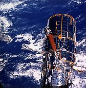 Hubble Space Telescope above the Earth. NASA photograph.