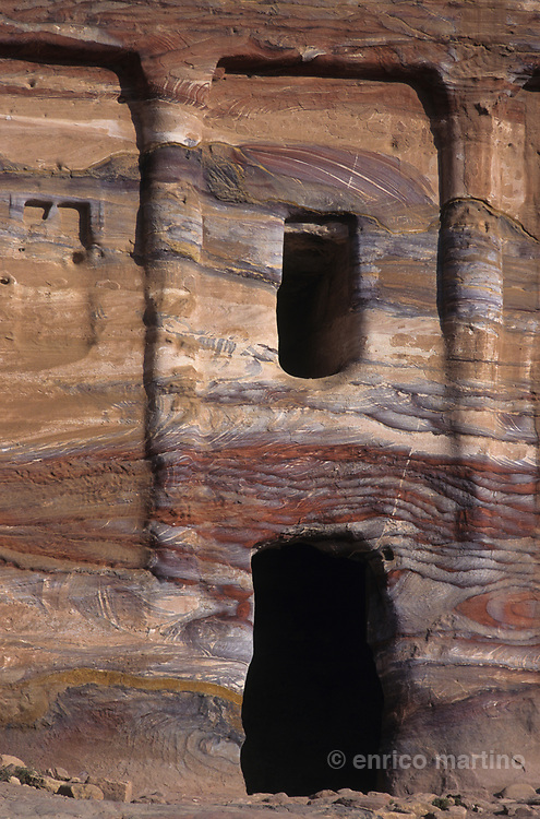 The Royal Tombs, the series of large tomb facades carved out of the west face of Al-Khubta mountain.