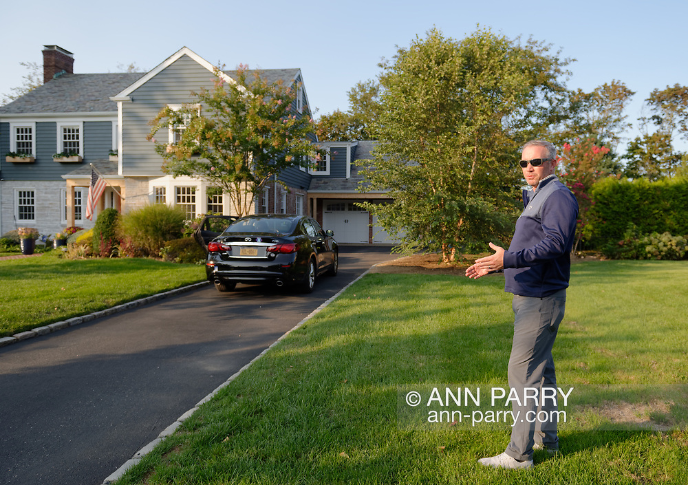 Rockville Centre, New York, U.S. September 22, 2020. BRIAN SCHIELE is standing on east side of his front yard where he can view the room he GUESSES was Ruth Bader 's when she stayed with Martin Ginsburg's family for a while. It was the room originally meant as a maid's room on right side of house. Bader and Ginsburg's wedding was held at that home in 1954. The Schiele family bought the Colonial home on Long Island in 2016, from Martin Ginsburg's sister and brother-in-law, Claire and Edward Steipleman.