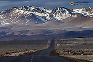 East Steens Road leads towards snow capped Pueblo Mountains near Fields, Oregon, USA