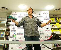 Mitch Benn <br /> Comedian and author <br /> Personal appearance and book signing at Forbidden Planet, London, Great Britain <br /> 15th July 2014 <br /> <br /> Mitch Benn<br /> Terra's World <br /> <br /> published by Gollancz an imprint of the Orion publishing group <br /> <br /> Photograph by Elliott Franks