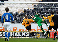 Photo: Jed Wee/Sportsbeat Images.<br /> Hull City v Cardiff City. Coca Cola Championship. 01/12/2007.<br /> <br /> Hull's Stephen McPhee steers the ball past a diving Kasper Schmeichel in the Cardiff goal to open the scoring.