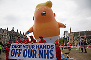 The Trump Baby, a six metre high inflatable blimp flying above Westminster prior to protests against the state visit of US President Donald Trump on 4th June 2019 in London, United Kingdom. Organisers Together Against Trump which is a collaboration between the Stop Trump Coalition and Stand Up To Trump, have organised a carnival of resistance, a national demonstration to protest against President Trump's policies and politics during his official UK visit.