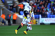 Bolton Wanderers' Kevin McNaughton gets to the ball ahead of Brentfords' Andre Gray. Skybet football league championship match, Bolton Wanderers v Brentford at the Macron stadium in Bolton, Lancs on Saturday 25th October 2014.<br /> pic by Chris Stading, Andrew Orchard sports photography.