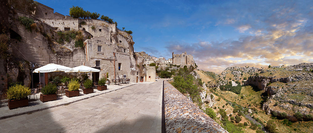 """Vew of """"la Gravina"""" ravine and the Sassi of Matera, Basilicata, Italy. A UNESCO World Heritage site.<br /> <br /> The area of Matera has been occupied since the Palaeolithic (10th millennium BC) making it one of the oldest continually inhabited settlements in the world. <br /> <br /> The town of Matera was founded by the Roman Lucius Caecilius Metellus in 251 BC and remained a Roman town until  was conquered by the Lombards In AD 664 becoming part of the Duchy of Benevento.  Matera was subject to the power struggles of southern Italy coming under the rule of the Byzantine Roman, the Germans and finally Matera was ruled by the Normans from 1043 until the Aragonese took possession in the 15th century. <br /> <br /> At the ancient heart of Matera are cave dwellings known as Sassi. As the fortunes of Matera failed the sassy became slum dwelling and the appalling living conditions became be the disgrace of Italy. From the 1970's families were forcibly removed from the Sassi and rehoused in the new town of Matera. Today tourism has regenerated Matera and the sassi have been modernised and are lived in again making them probably the longest inhabited houses in the world dating back 9000 years. .<br /> <br /> Visit our ROMAN ART & HISTORIC SITES PHOTO COLLECTIONS for more photos to download or buy as wall art prints https://funkystock.photoshelter.com/gallery-collection/The-Romans-Art-Artefacts-Antiquities-Historic-Sites-Pictures-Images/C0000r2uLJJo9_s0<br /> .<br /> <br /> Visit our MEDIEVAL PHOTO COLLECTIONS for more   photos  to download or buy as prints https://funkystock.photoshelter.com/gallery-collection/Medieval-Middle-Ages-Historic-Places-Arcaeological-Sites-Pictures-Images-of/C0000B5ZA54_WD0s"""