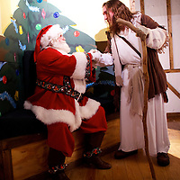 """Michael Grant, 28, """"Philly Jesus,"""" greets Santa Claus at Macy's department store in Philadelphia, PA on December 18, 2014.  Nearly everyday for the last 8 months, Grant has dressed as Jesus Christ, and walked the streets of Philadelphia to share the Christian gospel by example.  He quickly acquired the nickname of """"Philly Jesus,"""" which he has gone by ever since."""