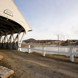 The covered bridge and Wausau Paper mill in Groveton, New Hampshire.  Upper Ammonoosuc River.