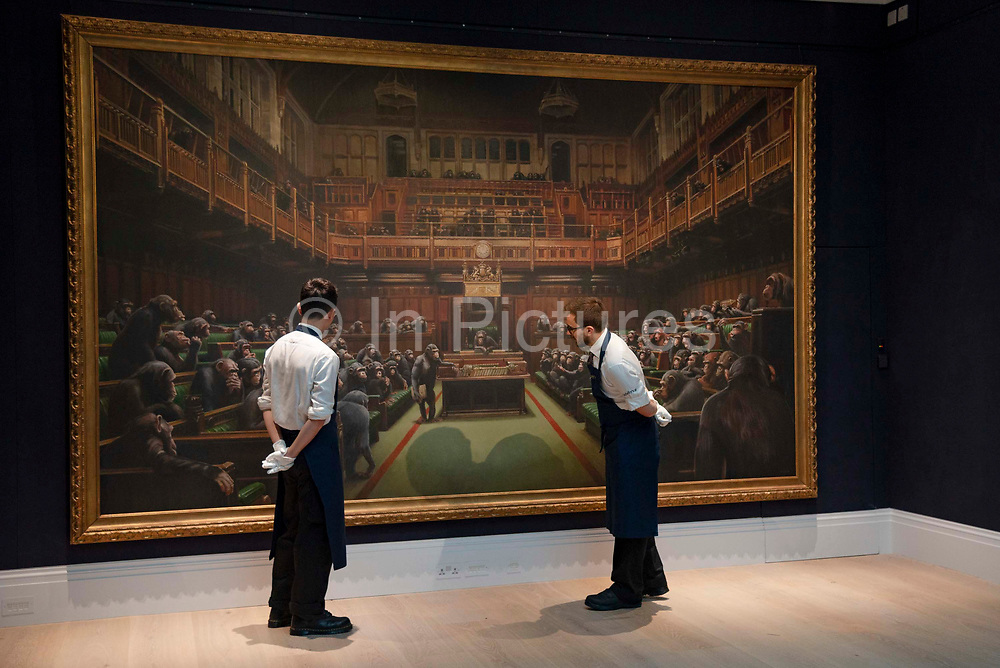 Art handlers views  Banksy's Desolved Parliament at Sothebys auction house in London, United Kingdom on 27th September 2019. The work is estimated to reach GBP 1.5 - 2 million when it goes under the hammer.