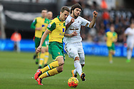 Alberto Paloschi of Swansea city ® goes past Ryan Bennett of Norwich city.Barclays Premier league match, Swansea city v Norwich city at the Liberty Stadium in Swansea, South Wales  on Saturday 5th March 2016.<br /> pic by  Andrew Orchard, Andrew Orchard sports photography.