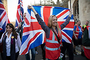 After walking all the way from Sunderland to London, the March to Leave walkers arrive to join thousands of Leave supporters gathered in Parliament Square to protest against the delay to Brexit, on the day the UK had been due to leave the EU on 29th March 2019 in London, United Kingdom. As parliament debated and voted inside the commons, rejecting the Withdrawal Agreement again, outside in Westminster various groups of demonstrators including the Yellow Jackets, Leave Means Leave supporters and the Democratic Football Lads Alliance, gathered to voice their wish to leave the European Union, and their frustration that Brexit is not being delivered, waving Union flags and Believe in Britain placards.