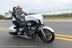 Brian Klock of Klock Werks in Mitchell, SD out riding with Vanessa Nay along the Atlantic Ocean on their 2017 Jack Daniels Indian Chieftain limited edition that Brian designed during Daytona Beach Bike Week. FL. USA. Monday March 13, 2017. Photography ©2017 Michael Lichter.
