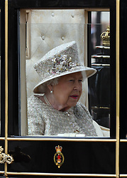 Queen Elizabeth ll rides in the Scottish State Coach during Trooping the Colour in London