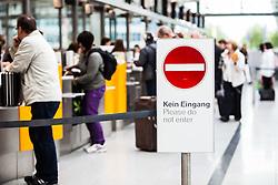 THEMENBILD, Airport Muenchen, Franz Josef Strauß (IATA: MUC, ICAO: EDDM), Der Flughafen Muenchen zählt zu den groessten Drehkreuzen Europas, rund 100 Fluggesellschaften verbinden ihn mit 230 Zielen in 70 Laendern, im Bild wartende Passagiere, Hinweisschild Kein Eingang // THEME IMAGE, FEATURE - Airport Munich, Franz Josef Strauss (IATA: MUC, ICAO: EDDM), The airport Munich is one of the largest hubs in Europe, approximately 100 airlines connect it to 230 destinations in 70 countries. picture shows: waiting passengers, Please do not enter sign, Munich, Germany on 2012/05/06. EXPA Pictures © 2012, PhotoCredit: EXPA/ Juergen Feichter