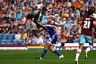 Lukas Jutkiewicz of Burnley goes for a ride on James Tarkowski of Brentford. Skybet football league championship match, Burnley  v Brentford at Turf Moor in Burnley, Lancs on Saturday 22nd August 2015.<br /> pic by Chris Stading, Andrew Orchard sports photography.