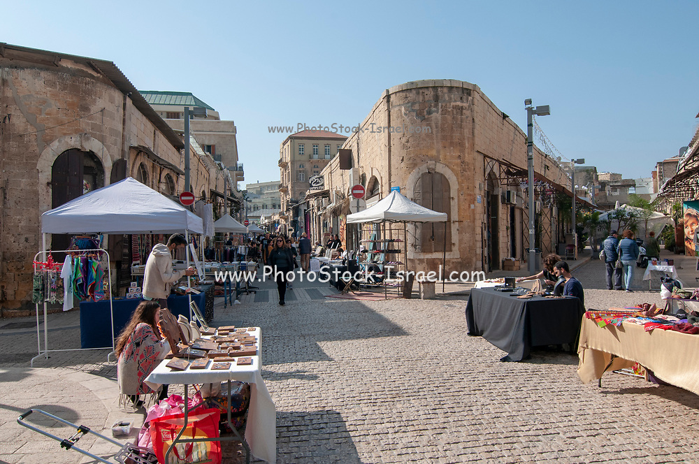 handcrafts and art for sale on stall in the weekly fair at the Greek Market, Jaffa, Israel