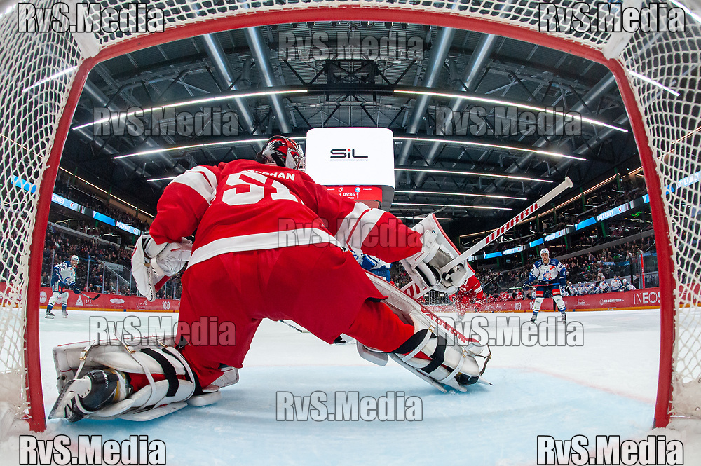 LAUSANNE, SWITZERLAND - OCTOBER 01: Dario Trutmann #86 of ZSC Lions scores a goal against Goalie Tobias Stephan #51 of Lausanne HC during the Swiss National League game between Lausanne HC and ZSC Lions at Vaudoise Arena on October 1, 2021 in Lausanne, Switzerland. (Photo by Monika Majer/RvS.Media)