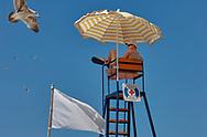 BY THE SEA - PIRAN - colour photo art pictures by Paul Williams of a lifeguard on his lookout seat . Taken in 2007 .<br /> <br /> Visit our REPORTAGE & STREET PEOPLE PHOTO ART PRINT COLLECTIONS for more wall art photos to browse https://funkystock.photoshelter.com/gallery-collection/People-Photo-art-Prints-by-Photographer-Paul-Williams/C0000g1LA1LacMD8