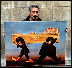 Artist Kaya Mar with his work showing the late Lady Thatcher in a coffin carried by the shoeless poor and have nots, lefr, and the haves and fat cats right. The painting was done after her death. Photo taken in London, London, UK,  April 16, 2013, Photo by: Max Nash / i-Images<br /> <br /> File photo - One year ago: Baroness Thatcher died.<br /> On Tue, Apr 8 2014 it will be one year since the Longest-serving UK Prime Minister of the 20th century, the first and only woman to serve in the role to date, died on April 8, 2013  after suffering a stroke.