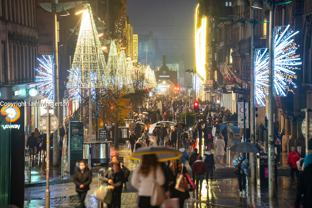 Glasgow, Scotland, UK. 20 November 2020. On evening shortly before the severest level 4 lockdown will be imposed at 6pm, shoppers are out on the streets of Glasgow doing last minute Christmas shopping before the shops close for 3 weeks. Views in evening as shops and businesses are closing. Pictured; Night view along Buchanan Street still busy with people  .Iain Masterton/Alamy Live News