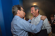 Former Texas Governor and GOP presidential hopeful Rick Perry greets former SC Governor Mark Sanford before holding a town hall aboard the USS Yorktown in Mount Pleasant, South Carolina.