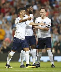 England's Jeremy Lynch (left) celebrates scoring his side's second goal of the game with team mates during the UNICEF Soccer Aid match at Old Trafford, Manchester.