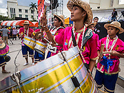 """15 NOVEMBER 2013 - BANGKOK, THAILAND: Students dressed in traditional Thai outfits march into the protest venue during an anti-government protest in Bangkok. Tens of thousands of Thais packed the area around Democracy Monument in the old part of Bangkok Friday night to protest against efforts by the ruling Pheu Thai party to pass an amnesty bill that could lead to the return of former Prime Minister Thaksin Shinawatra. Protest leader and former Deputy Prime Minister Suthep Thaugsuban announced an all-out drive to eradicate the """"Thaksin regime."""" The protest Friday was the biggest since the amnesty bill issue percolated back into the public consciousness. The anti-government protesters have vowed to continue their protests even though the Thai Senate voted down the bill, thus killing it for at least six months.     PHOTO BY JACK KURTZ"""