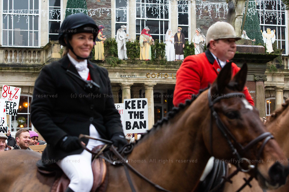 Carmarthen, UK. 1 January, 2020.<br /> The Carmarthenshire Hunt meets anti-hunt protesters in Carmarthen town centre on New Year's Day.<br /> Credit: Gruffydd Ll. Thomas/Alamy Live News