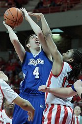 01 February 2014:  Blake Danielak works in defended by Tony Wills during an NCAA Missouri Valley Conference (MVC) mens basketball game between the Drake Bulldogs and the Illinois State Redbirds  in Redbird Arena, Normal IL.