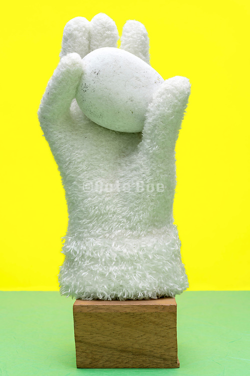 gloved hand with stone