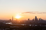 London Skyline at sunset seen from Isle of Dogs, London, England, UK
