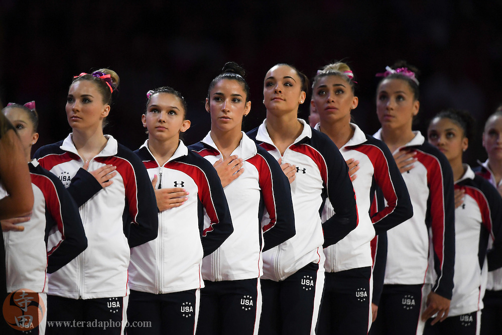July 8, 2016; San Jose, CA, USA; (L-R) MyKayla Skinner, Emily Schild, Aly Raisman, Maggie Nichols, Ashton Locklear, Amelia Hundley, and Laurie Hernandez stand for the national anthem in the women's gymnastics U.S. Olympic team trials at SAP Center.