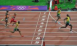 Olympics - London 2012 Olympic Games - 9/8/12.Athletics - Men's 200m - Final - Usain Bolt (JAM) beats Yohan Blake (JAM) with Warren Weir (JAM) making it a Jamaican one two three..© pixathlon *** Local Caption ***