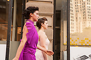 Lead dancer Jessica Grippo in the magenta, and anotehr dancer, by the Flatiron Building.